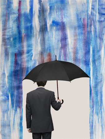 against the current: man with an umbrella in a storm