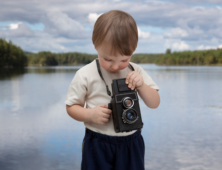 felicity: a young boy with an old camera