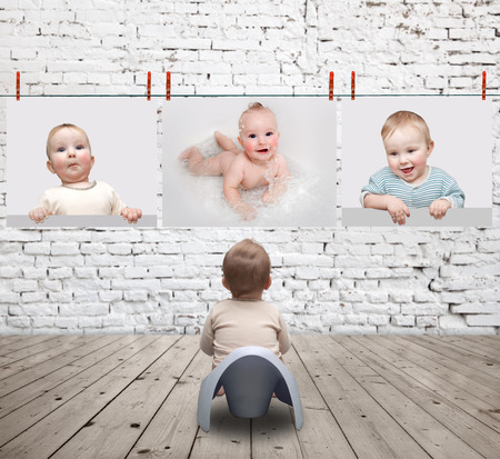 pictures: small child on the potty looking at photos