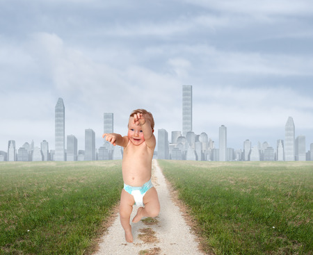 new path: small child running through a field of city Stock Photo
