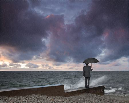 black sea: man with an umbrella in a storm