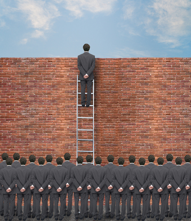 impasse: young businessman overcomes an obstacle for the consideration of the crowd