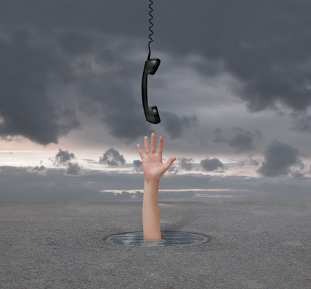 inconvenience: hand gives the phone a man who is drowning Stock Photo