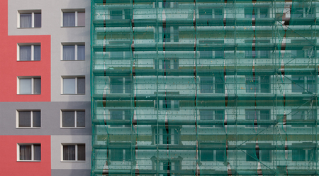 tenement: photo of an apartment building with scaffolding Stock Photo