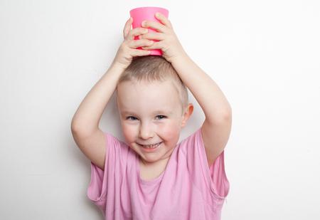 felicity: little boy in a pink shirt
