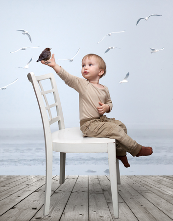 sincere: small child playing with a bird