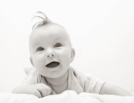 portrait smiling baby in black and white