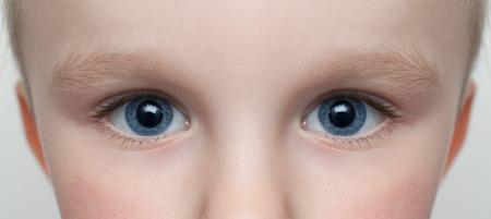 photo of child blue big eyes Stock Photo