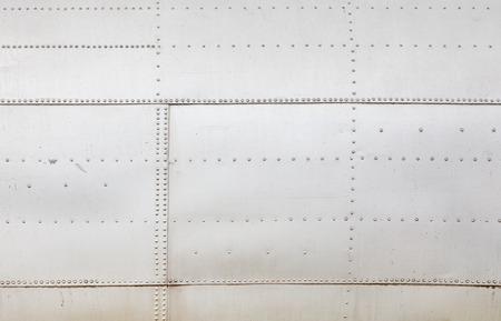 aluminium texture: shiny metal plate attached rivets