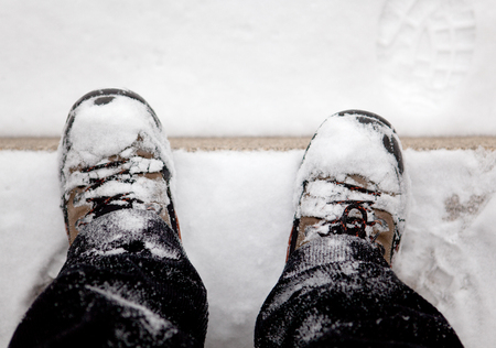 snow boots after a winter walk Stock Photo