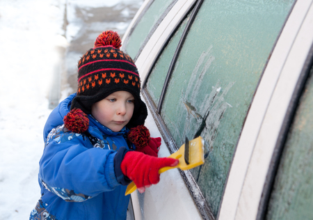 boy is cleaning snow after snow calamity Stock Photo