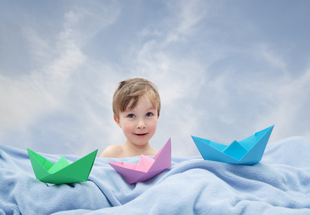felicity: Child playing with paper boating
