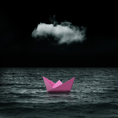 abandoned pink paper ship at sea