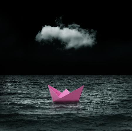 dark skies: abandoned pink paper ship at sea