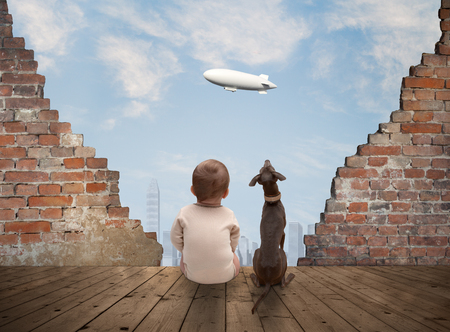 baby and dog watching the airship from the ancient ruins Stock Photo