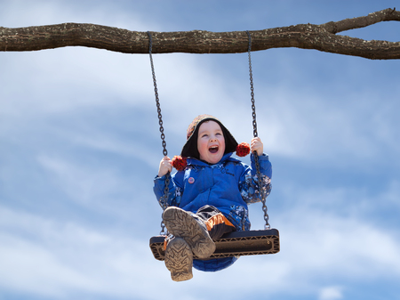 little boy swinging on a swing