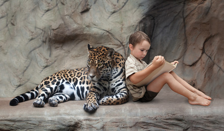 The child reads a book to his friend, panthere Stock Photo