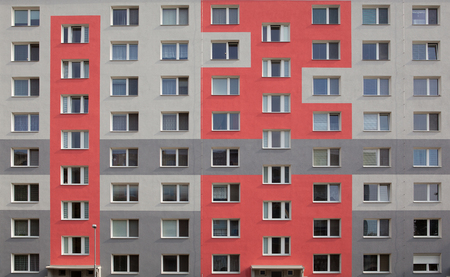 photo of an apartment building with red decoration of the facade