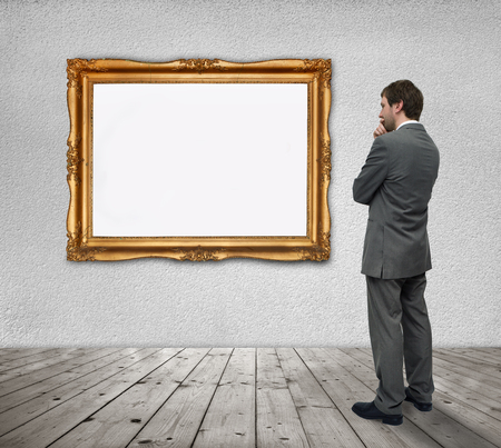 blank image in a golden frame and a young businessman
