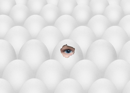 an endless series of white eggs and blue eye art concept