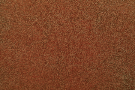 macro shot of a structure of brown artificial leather