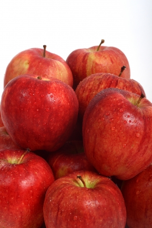 A pile of ripe, fresh, juicy, red apples photo