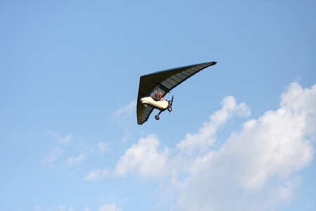 Hang gliding is flying in the blue sky