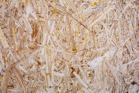 Surface of Pressed Wood Close up. Particleboard Background Texture.