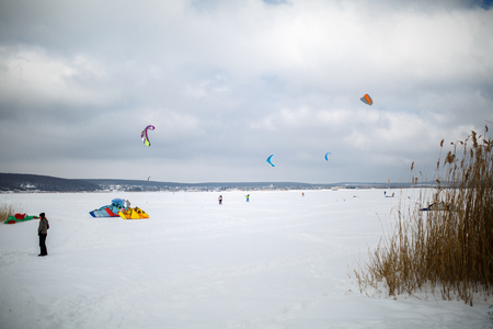 snow kiting on a snowboard on a frozen lake.