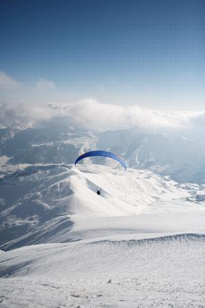 Winter paragliding in Gudauri mountains.