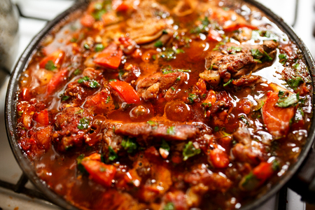 Chakhokhbili. Chicken with herbs and tomato Stock Photo