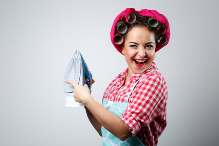 Happy crazy girl with iron. Stock Photo