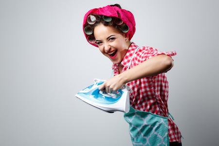 Happy crazy girl with iron. Stock Photo