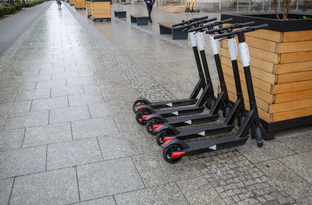 Electric scooters ready for rent. City transport Stock fotó