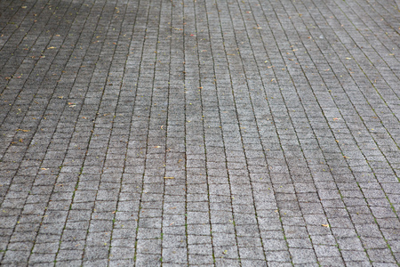 Material for sidewalk. Grey paving stone. Background