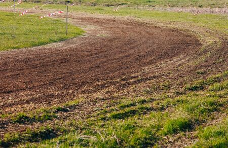 Turn of atv race track. Dust and grass. Stock fotó