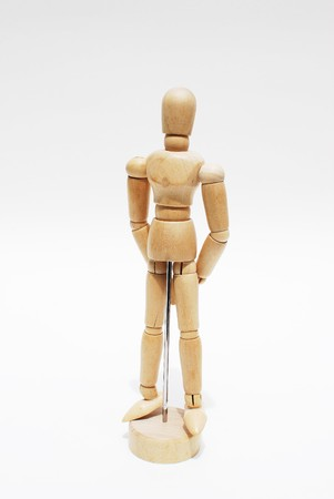 Wooden mannequin human scale model isolated photo