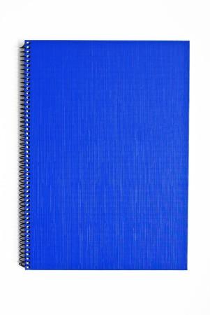 Blue notebook isolated on white background photo