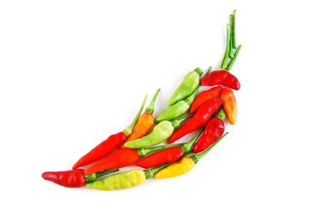 red chilli pepper plant: aligned colorful chili isolated on white background