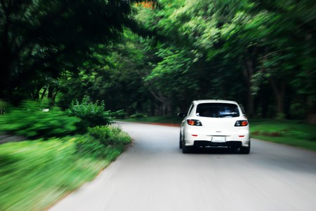 speed drive following white car on the road Stock Photo - 8043330