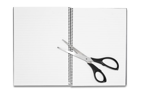 blank notebook with scisscors isolated photo