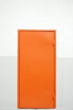 closed orange factory door Stock Photo - 8103743