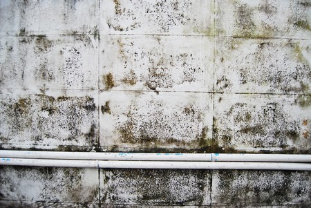 dirt grunge old white concrete wall with pipeline background texture photo