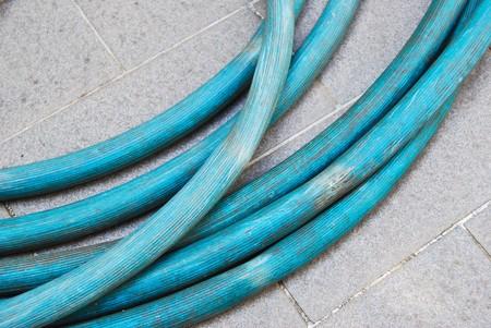 blue rubber hose tube for garden work photo