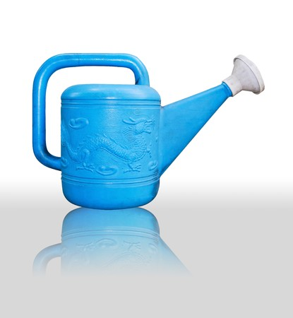 asian style blue water can for watering in garden isolated photo