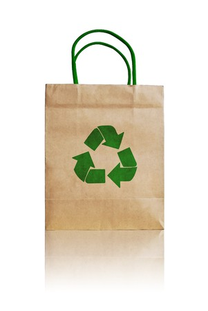 brown shopping bag with recycle symbol isolated on white background photo