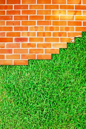 Brick wall fence and grass field background texture photo