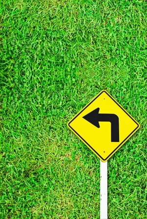 Turn right traffic sign on grass field background texture photo