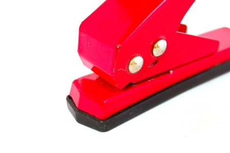 paper punch: red office paper punch isolated on white background Stock Photo