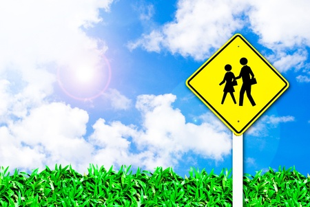 school warning traffic road sign on beautiful sky background photo